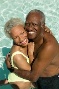 couple cuddling in a swimming pool