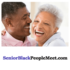 a mature African American couple laughing together