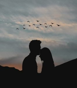 A couple kissing at sunset
